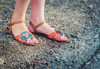 Sandals on the feet of the girl